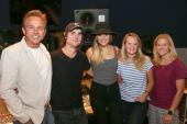Kelsea Ballerini And Ross Copperman Volunteer During ACM Lifting Lives Camp